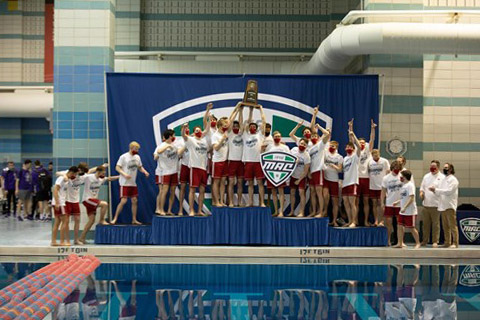 The Miami Men's Swimming and Diving Team celebrates their league championship, which was held this year in their home pool at the Nixon Aquatic Center.