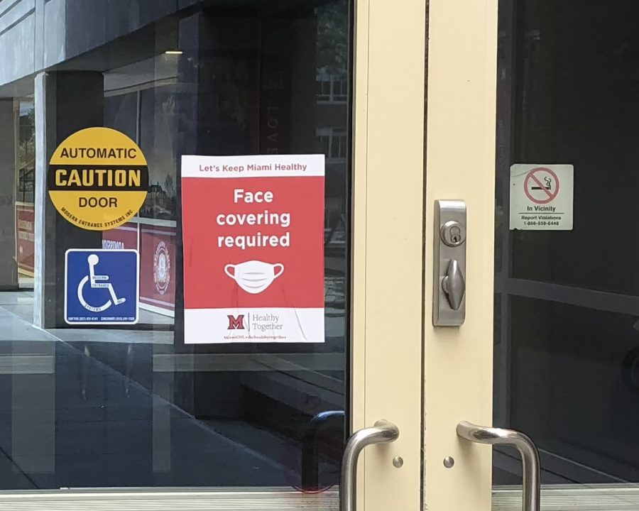 Stickers showing that masks are required, such as this one on a door to Shriver Center, will remind returning students that masks are required to be worn inside all Miami University buildings this fall.