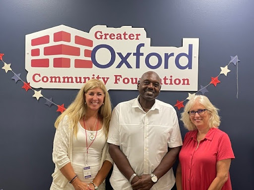 Melford Edwards stands between Holli Morrish, communications director for Talawanda School District (left), and Betsy Hope executive director of the Greater Oxford Community Foundation, during a recent celebration announcing the Melford Edwards Scholarship.