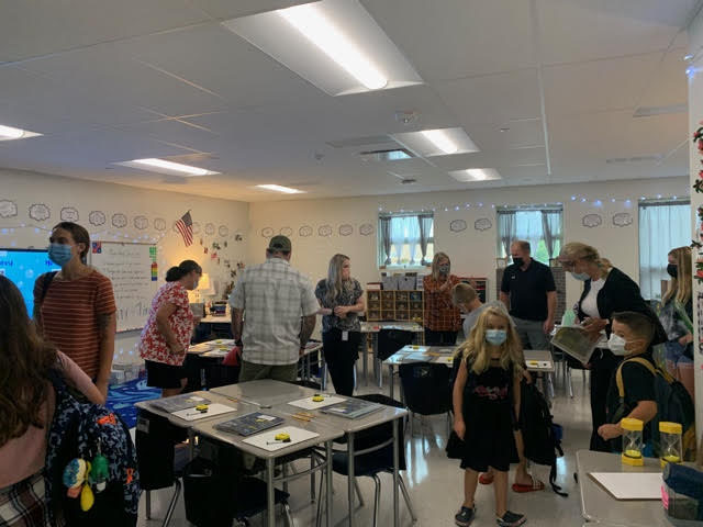 Masked students and parents mingled in the new classrooms at Thursday's open house.