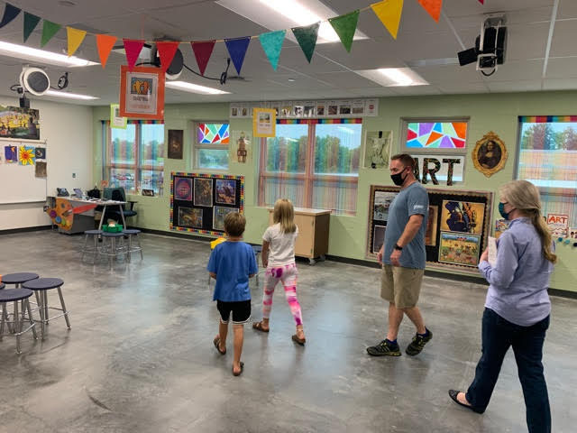 Aaron Weekley, father of a fifth grader and second grader who will be attending the school, admire the art room Thursday.