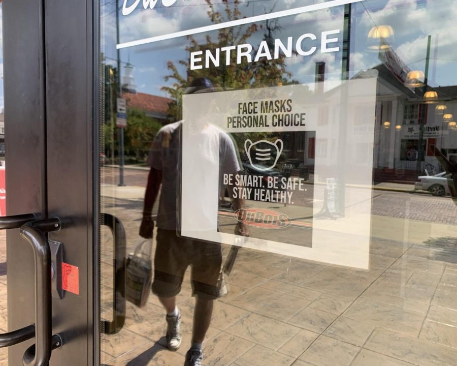Signs such as this one on the door of Dubois Book Store, 118 E. High St., indicate that customers have a choice about wearing masks inside. An emergency ordinance will be considered at a special Oxford City Council meeting on Monday that would make masks mandatory.