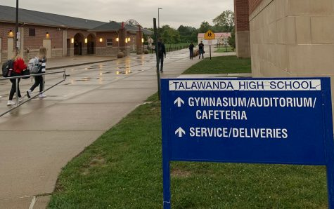 Once they enter the building, Talawanda High School students take off their coats and put on their masks.