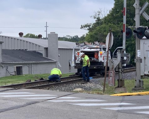 Repair crews inspect the Spring Street railroad crossing, soon to be closed for repairs.