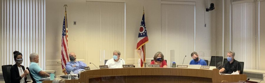 Council votes 6-1 at a special meeting Monday to require masks be worn inside all public spaces in the city. Councilor Glenn Ellerbe, second from left, was the only member of council unmasked during the meeting and the only member to vote against the ordinance.