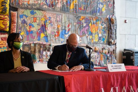 Miami President Gregory Crawford pledges Miami University's support to the Moon Shot for Equity initiative Wednesday in a ceremony with other college presidents at the Underground Railroad Freedom Center in Cincinnati.