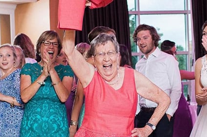 Winifred Pearson, seen here at her granddaughter's wedding in 2016, was known for an exuberant personality and was described by the university as one of Miami's most avid sports fans.