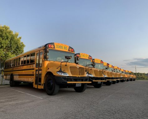 Talawanda's 32 school buses are now parked on a leased lot at the Chestnut Street site of the old Talawanda High School, which is soon to be redeveloped into a public transportation hub.