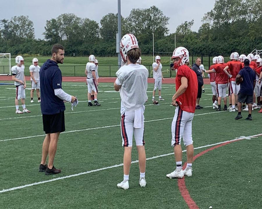 Talawanda's new football coach Jay Volker (in black) at a recent practice says he believes in being tough on the field and compassionate off the field.