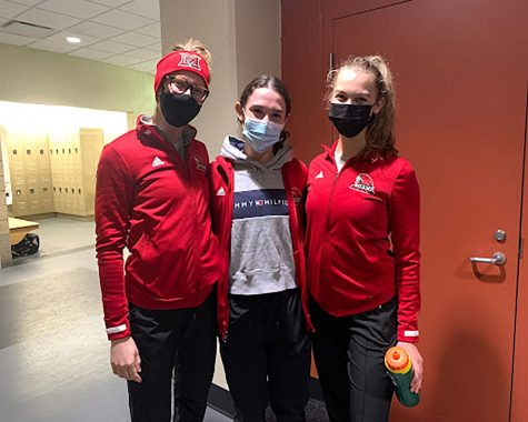 (Left to right) Miami University students Hannah McDougall, Sammie Levine, Annie Givens coach youngsters in the Learn to Skate program at Goggin Ice Center. Photo by Grace Callahan