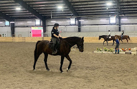 Equestrian team members practice in the middle of Miami's new indoor riding arena for a lesson at the indoor arena.