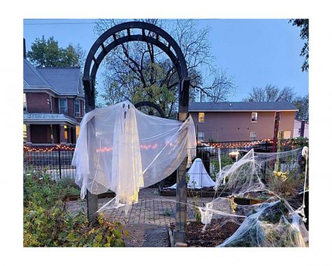 Ghosts fly through the shrubbery at the Oxford Community Arts Center's Haunted Garden this week.