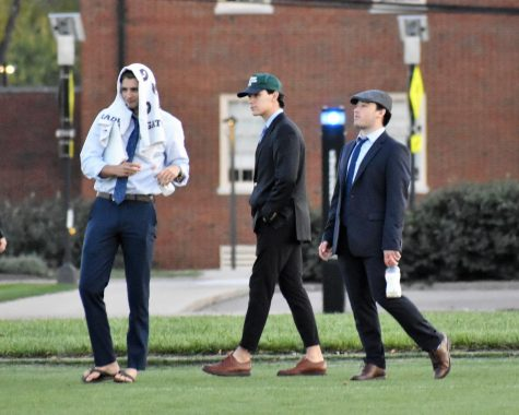 Left to right: Coaches Dominic Giovanetti, Nate Aliapoulios, Alec Stacy on the sideline of a women's club soccer game. The coaches all are members of Kappa Alpha Order fraternity.